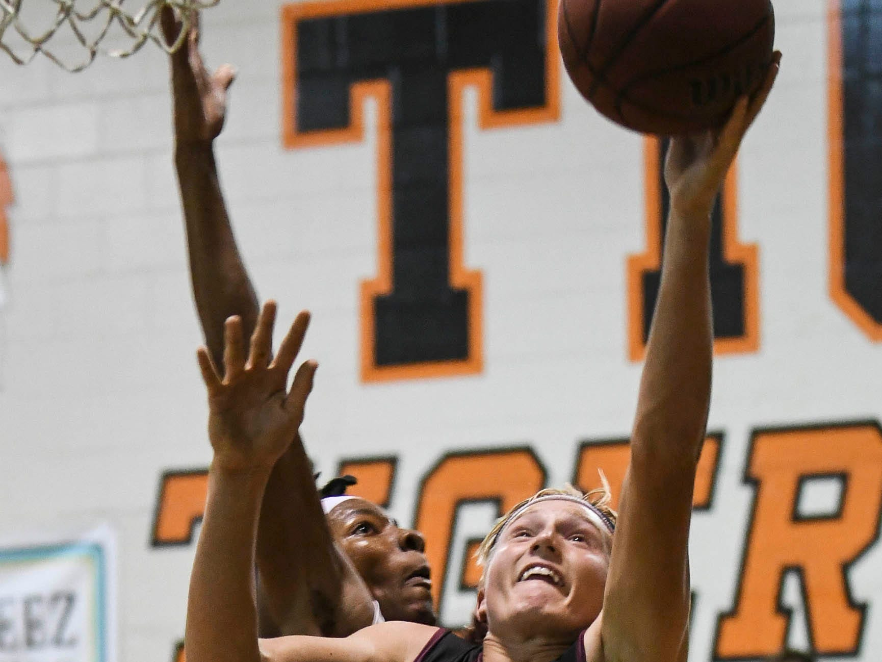 Thomas Waldron of Astronaut shoots and scores during Tuesday's game against Cocoa..