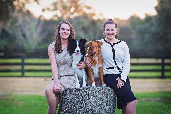 Junior handlers Emma Pitstick, with border collie Zuko, and Anna Pitstick, with Nova Scotia duck tolling retriever Swayze, will compete in the upcoming AKC National Championship in Orlando.