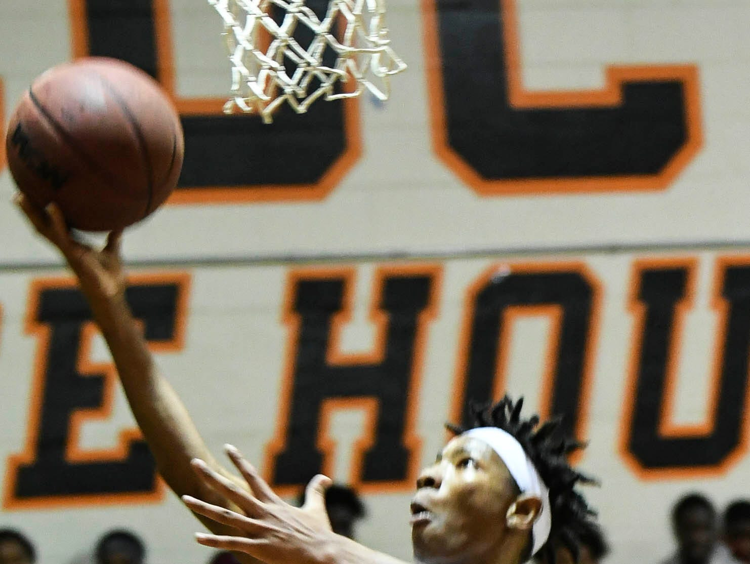 D Holmes of Cocoa scores during Tuesday's game against Astronaut. .