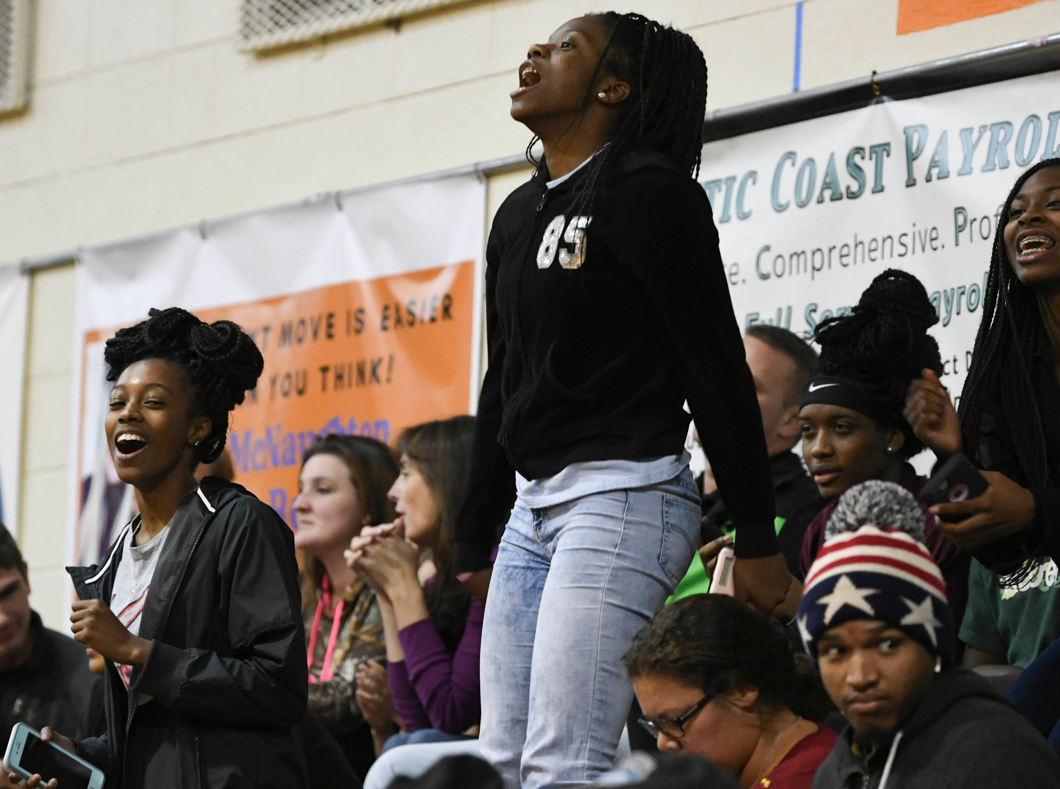 Fans cheer for the Cocoa Tigers during Tuesday's boys basketball game.