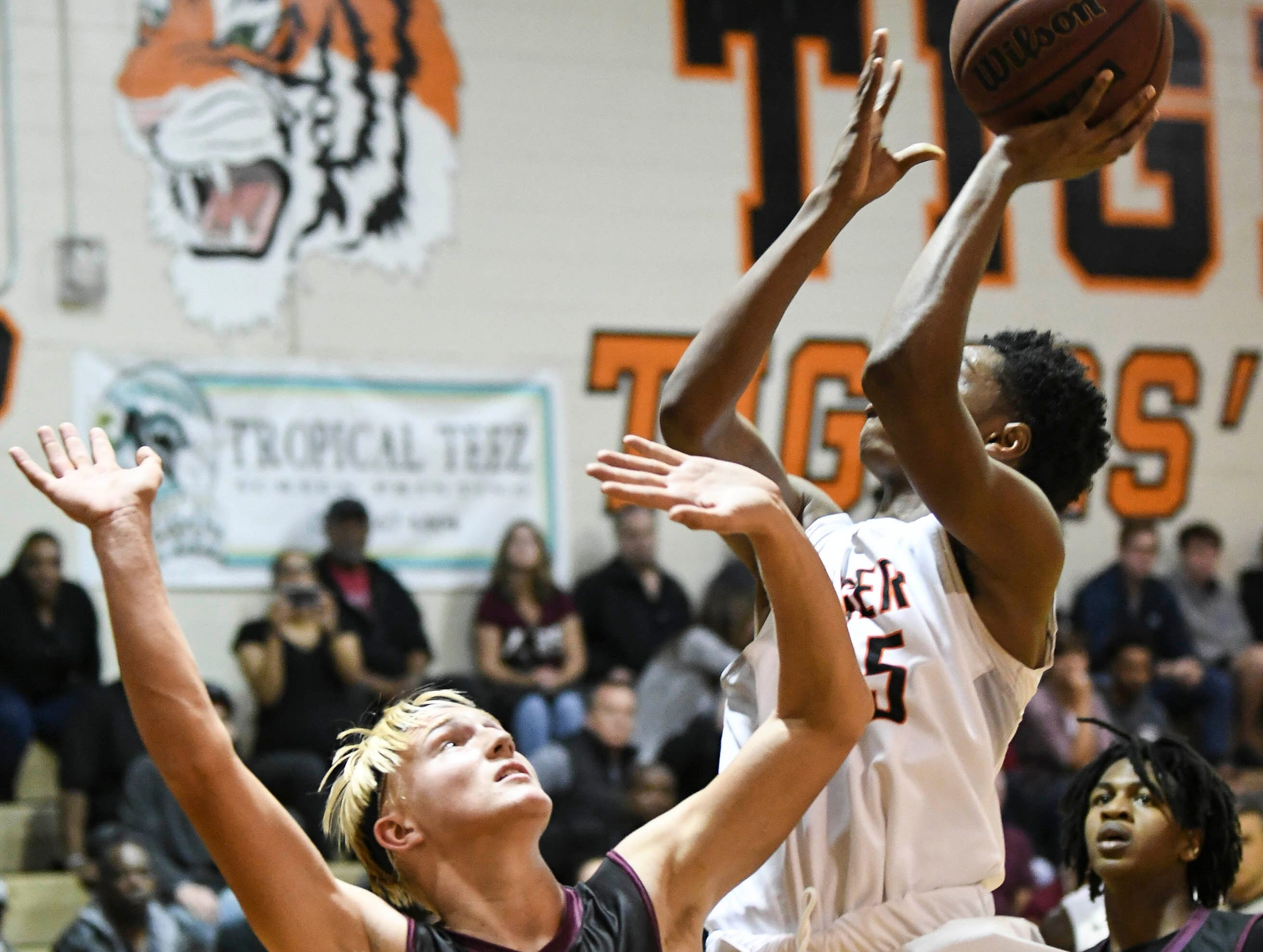 K Parker of Cocoa shoots over Thomas Waldron of Astronaut during Tuesday's game.