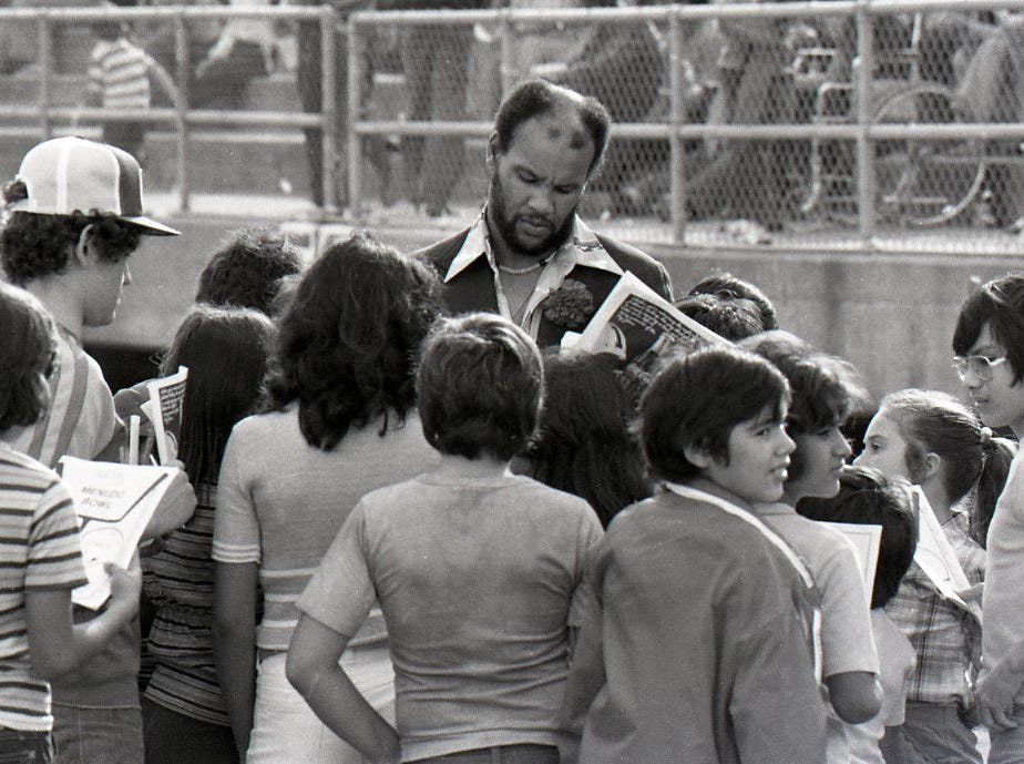 Miller grad and former NFL player Johnny Roland signing autographs at the Menudo Bowl in Corpus Christi on Jan. 9, 1978.