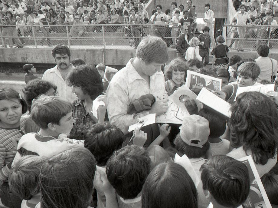 Kids crowded around to get autographs from former Dallas Cowboys player Bob Lilly at the Menudo Bowl in Corpus Christi on Jan. 9, 1978.