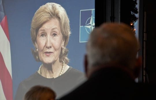 Nueces County Judge Loyd Neal watches a video statement from U.S. NATO Ambassador Kay Bailey Hutchison prior to his final State of the County speech on Nov. 28, 2018 at the Congressman Solomon P. Ortiz International Center.