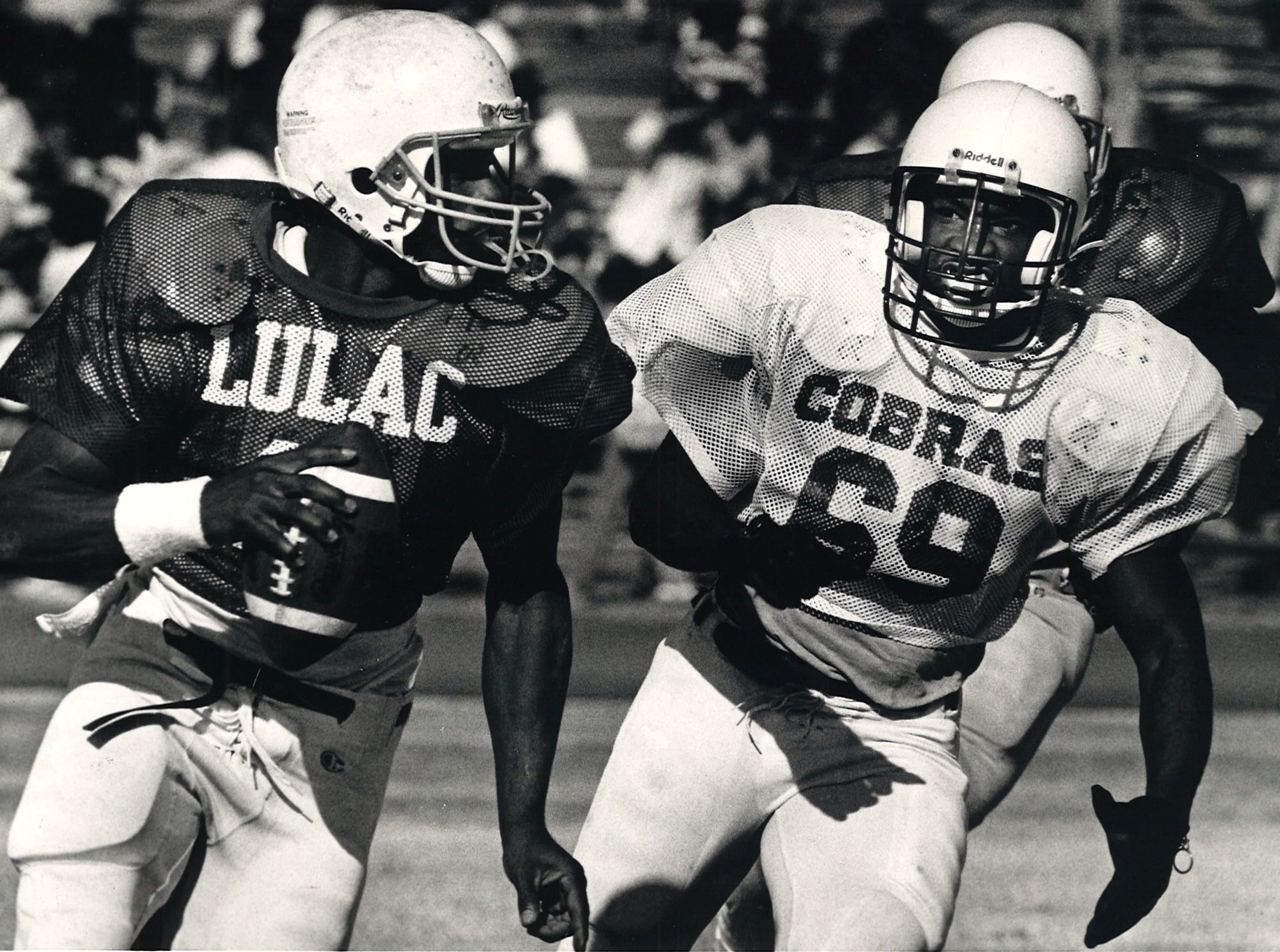 LULAC Bronco quarterback Clyde Coleman is pursued by Corpus Christi Army Depot Cobras during the Menudo Bowl at Buc Stadium in Corpus Christi on Jan. 30, 1988.