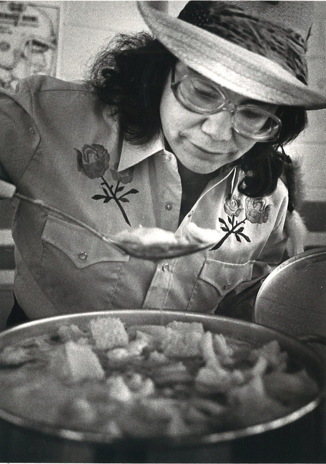 What's a Menudo Bowl with the menudo? Yolanda Benavides, the 1982 winner of the menudo contest, checks her 1983 entry prior to the judging in January 1983.