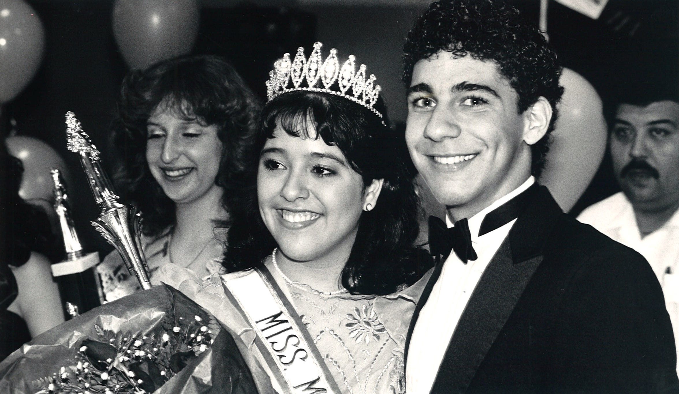 Carroll High School sophomore Tracy Benevidez was crowned the Menudo Bowl queen on Jan. 24, 1986. Former Menudo member Ricky Melendez (right) was one of the five judges that year.