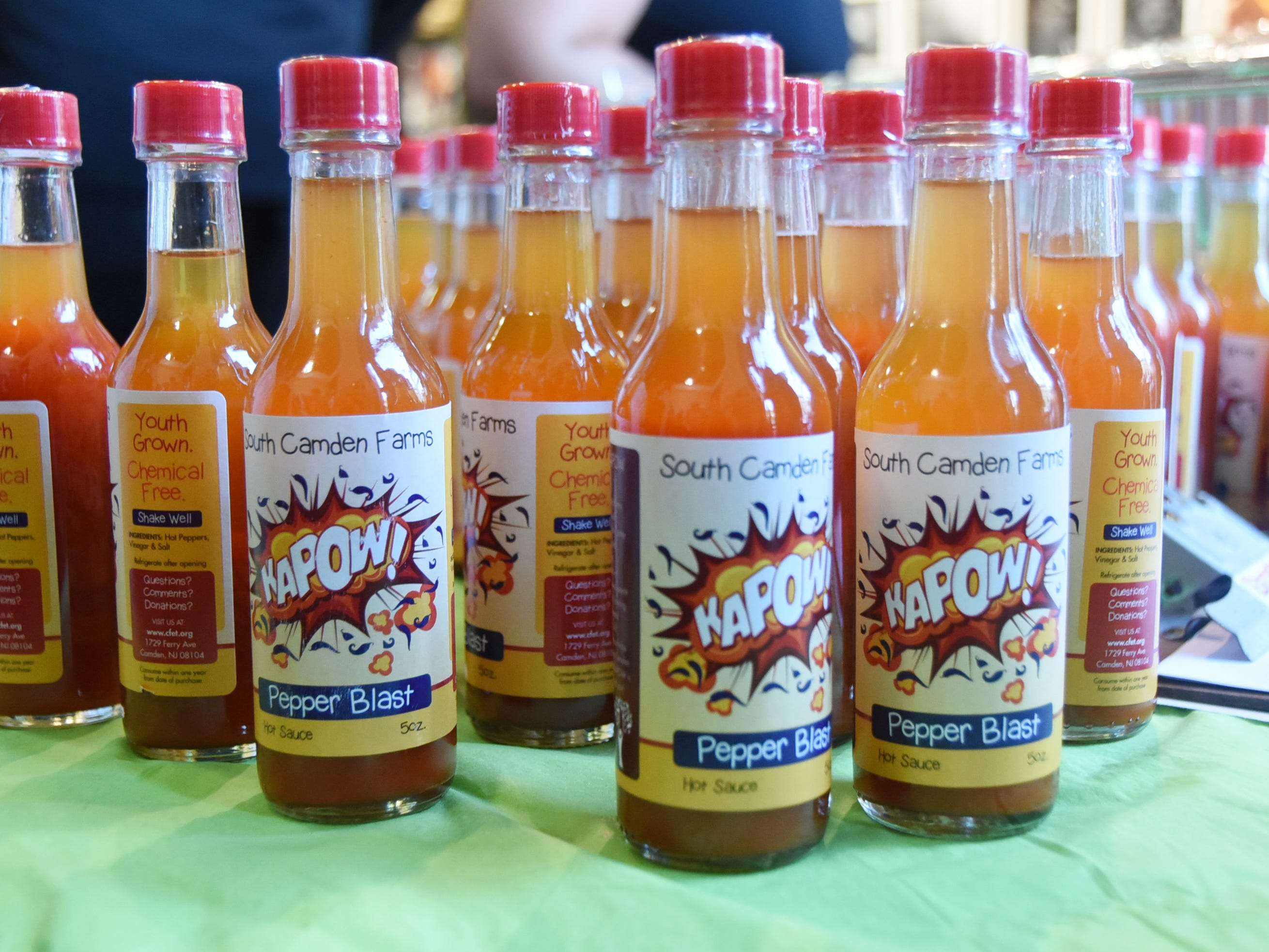 Bottles of hot sauce from the Center for Environmental Transformation in Camden are made with habanero peppers.