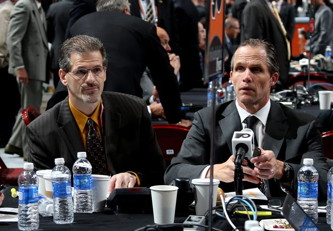 Ron Hextall, left, was fired by the Flyers on Monday as the team's general manager. Two days later they fired his right-hand man, Chris Pryor.