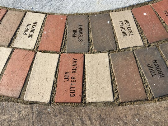 Statues of a police officer, a firefighter and a public works employee were installed at Florence Community Plaza. At the base of each are bricks engraved with the names of department members who have retired.