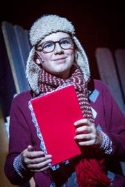 "In the Covedale Center for the Performing Arts' production of ""A Christmas Story,"" Ralphie, played by Eric Schaumloffel, has the face of an angel. But all he really want for Christmas is a Red Ryder Carbine Action 200-shot Range Model air rifle."
