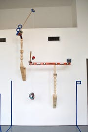 """An elaborately balanced art work by Harry Sanchez Jr. and Scottie Bellissemo. The work is part of """"Invisible Labor,"""" at the Wave Pool Gallery through Jan. 12. The show is built around the work of art installers who are responsible for nearly every aspect of how an exhibit is presented to the public."""