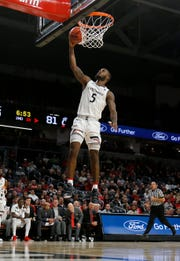 Cincinnati Bearcats guard Trevor Moore (5) breaks away and puts in a layup in the second half of the NCAA basketball game between the Cincinnati Bearcats and the Arkansas-Pine Bluff Golden Lions at Fifth Third Arena in Cincinnati on Tuesday, Nov. 27, 2018. The Bearcats improved to 6-1 with a 105-49 win.