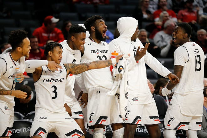 The Cincinnati Bearcats bench reacts after forward Mamoudou Diarra (20) scores from three point range in the second half of the NCAA basketball game between the Cincinnati Bearcats and the Arkansas-Pine Bluff Golden Lions at Fifth Third Arena in Cincinnati on Tuesday, Nov. 27, 2018. The Bearcats improved to 6-1 with a 105-49 win.
