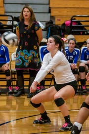 Junior libero Natalie Burchard helped Wyoming capture the program?s third-straight Cincinnati Hills League championship. The squad advanced to the regional semifinal round before falling to Alter Oct. 31. The Cowboys went 23-3. Thanks to Rod Apfelbeck Junior libero Natalie Burchard makes a dig while Head Coach Julie Plitt looks on during Wyoming's Regional semi-final loss to Alter at Wilmington on October 31st, 2012.  The Cowboys ended the year 23-3, 14-0 in the CHL.  Thanks to Rod Apfelbeck