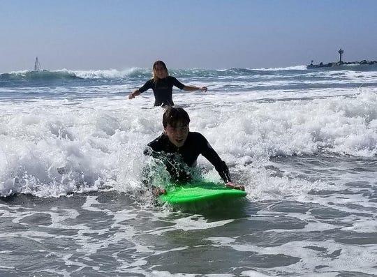 Elliot rides the waves in San Diego.