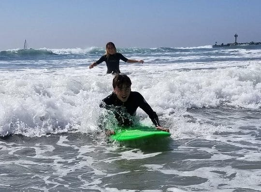 Elliot rides the waves in San Diego.