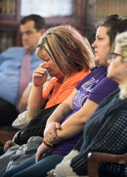 A court attendee sitting with the Rhoden family and friends wipes her eyes as she listens to the charges brought against George Wagner at the Pike County Courthouse for George's arraignment on Wednesday, November 28, 2018 in Waverly, Ohio.