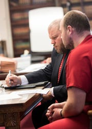 Co-counsel Richard Nash shows George Wagner IV the charges brought against him as Judge Randy Deering reads through the indictments at the Pike County Courthouse for his arraignment on Wednesday, November 28, 2018 in Waverly, Ohio.