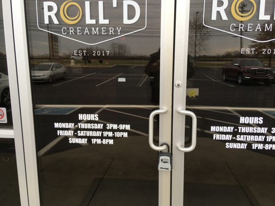 A lock box is on the door at Roll'd Creamery on Nov. 28, 2018. The shop was abandoned by its owners just over a year after its opening.