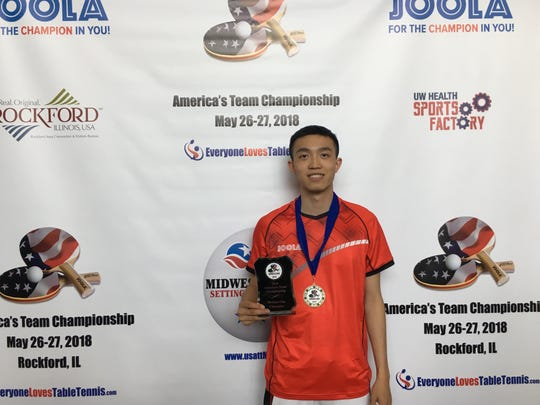 Bojun Zhangliang with his 1st place trophy at the America Team Table Tennis Championship in 2018.