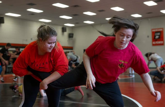 Alexandria Meyer and Shannon Stroud work on takedowns during practice.  NJSIAA is offering wrestling for girls this year and they will participate in an all girls tournament at the end of the season. Jackson Memorial Wrestling is fielding a full girls team this year. Boy and girls practice together although mostly match up with partners of their own sex for most drills.