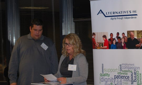 Paige Mangan and her son, Paul Finkler, speak at the Alternatives Mix 'n Mingle on Thursday, Nov. 8.