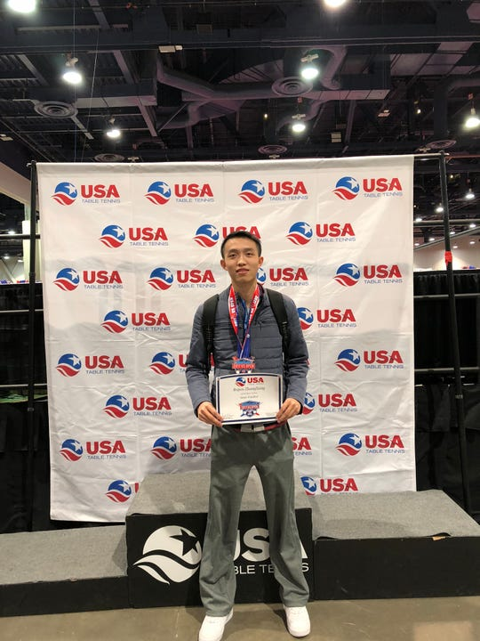 Bojun Zhangliang with his semi-finalist plaque at the USA Table Tennis  2017 US Open.