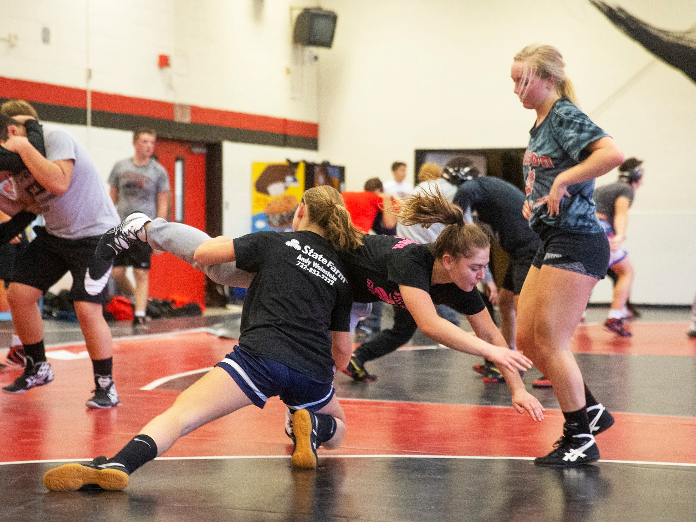 Hannah Reese works on takedowns with Kayla Gregory as Avary Meyers looks on. NJSIAA is offering wrestling for girls this year and they will participate in an all girls tournament at the end of the season. Jackson Memorial Wrestling is fielding a full girls team this year. Boy and girls practice together although mostly match up with partners of their own sex for most drills.