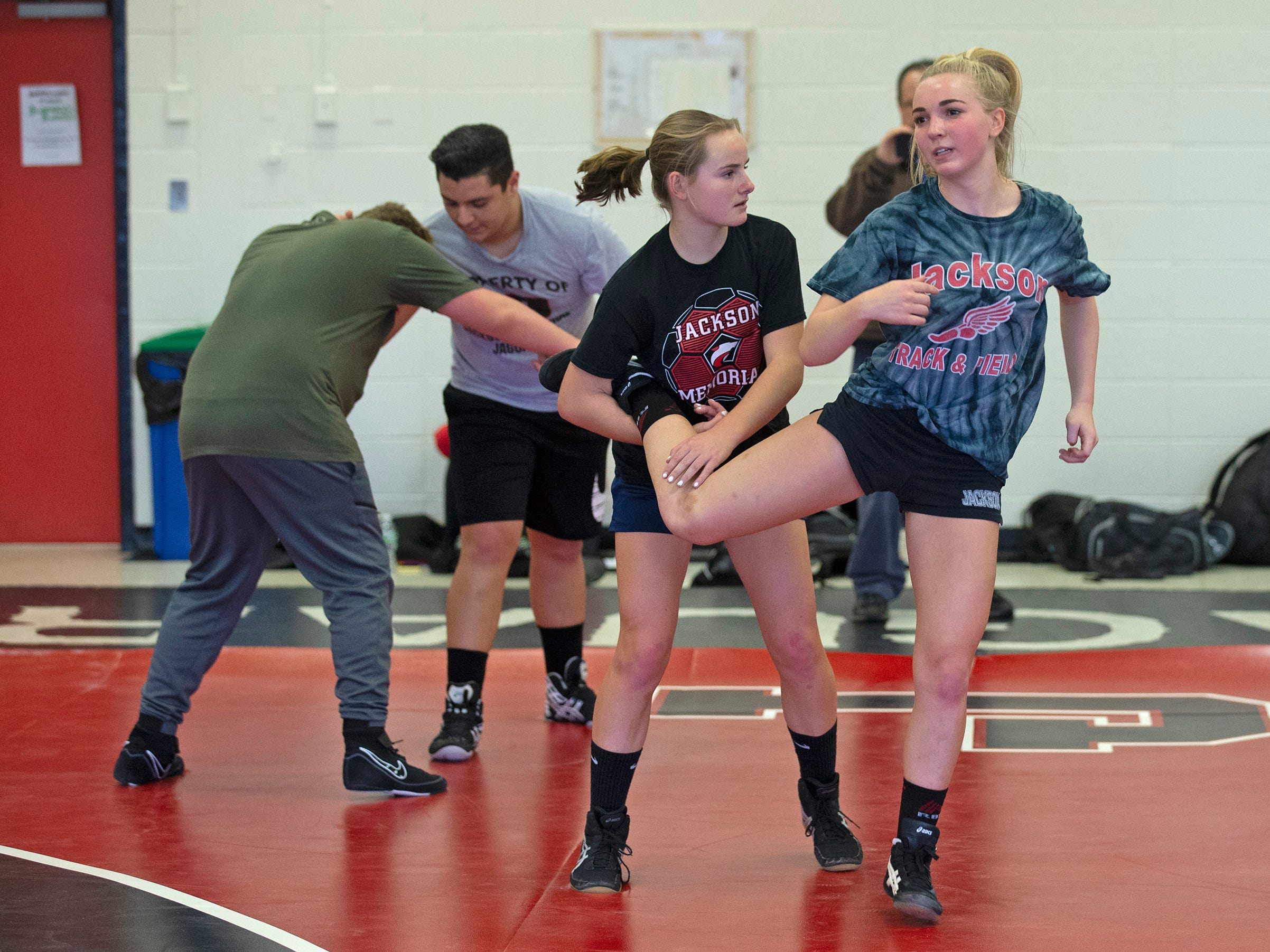 Hannah Reese and Avery Meyers  team up for warm up moves at the beginning of practice. NJSIAA is offering wrestling for girls this year and they will participate in an all girls tournament at the end of the season. Jackson Memorial Wrestling is fielding a full girls team this year. Boy and girls practice together although mostly match up with partners of their own sex for most drills.