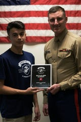 Joseph Campione as a 2018 Semper Fidelis All-American. He attended the Battles Won Academy this past July in Washington, D.C., a prestigious honor afforded to 99 students across America.  He is seen on the left of the photo accompanied by Staff Sgt. Kenneth Harper, a local recruiter for the Somerset area.