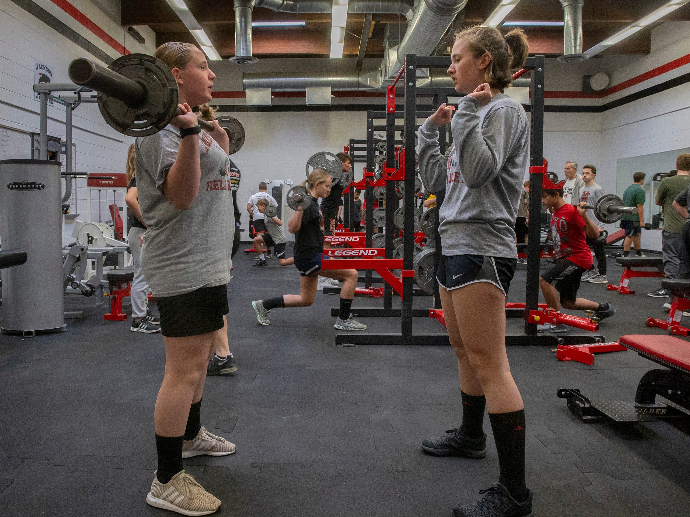 Abby Stanberry (right) gives tips to Jordyn Katz as the wrestlers do some weightlifting prior to wrestling practice. NJSIAA is offering wrestling for girls this year and they will participate in an all girls tournament at the end of the season. Jackson Memorial Wrestling is fielding a full girls team this year. Boy and girls practice together although mostly match up with partners of their own sex for most drills.