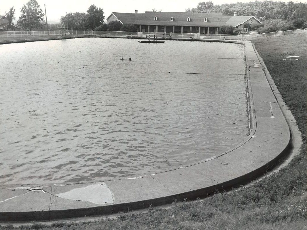 From 1958: Two swimmers are shown in the middle of the massive Camp Dodge pool.