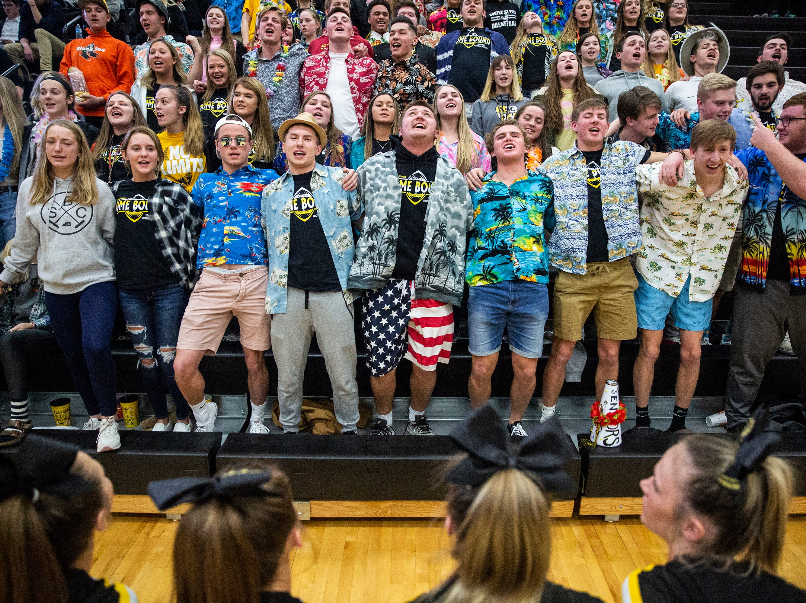 The Southeast Polk student section cheers during the Southeast Polk vs. Ankeny Centennial girls' basketball game on Tuesday, Nov. 27, 2018, at Ankeny Centennial High School.