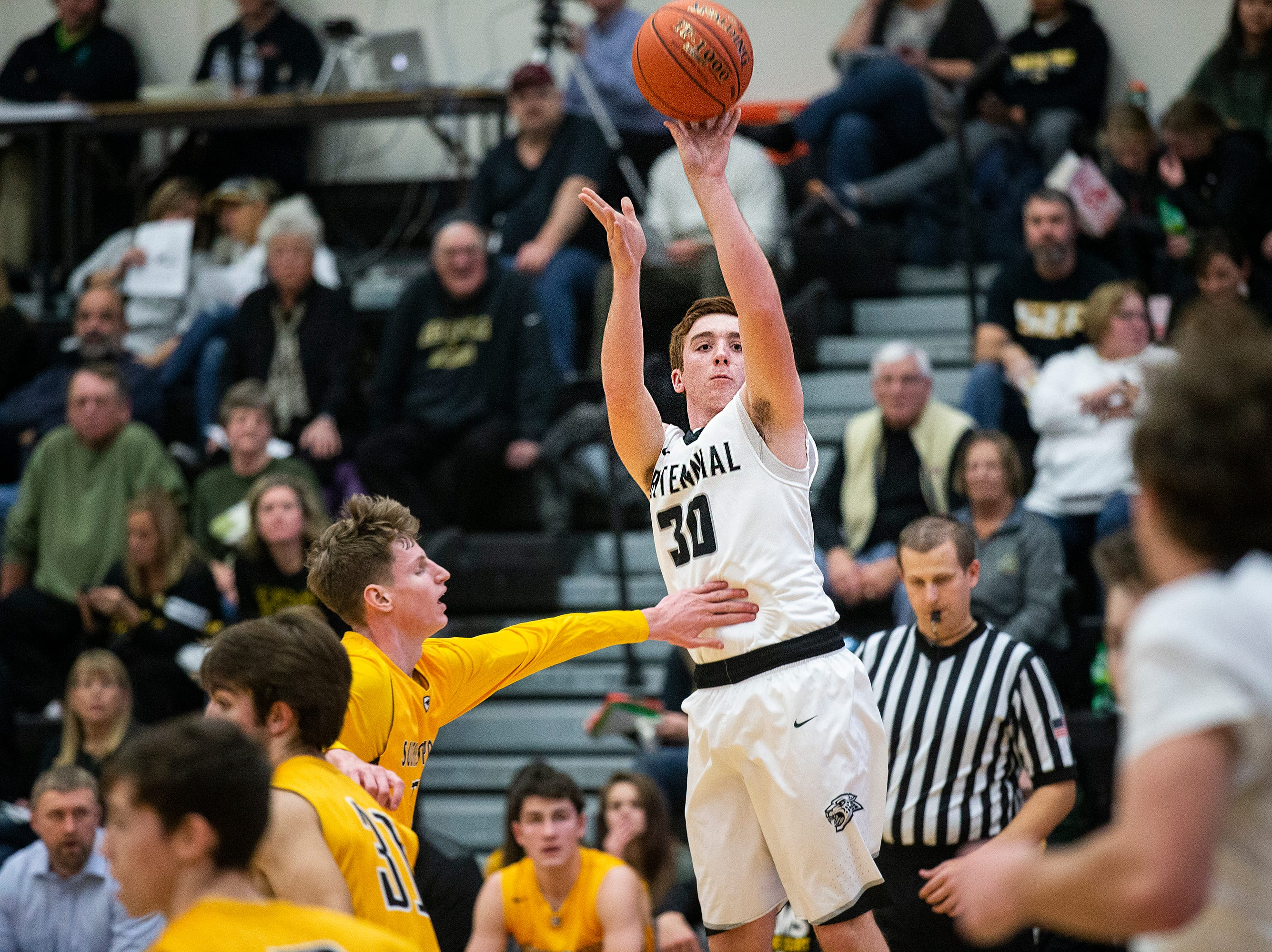 Centennial's Garret Severseike shoots the ball during the Southeast Polk vs. Ankeny Centennial boy's basketball game on Tuesday, Nov. 27, 2018, at Ankeny Centennial High School.