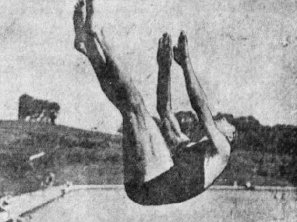 From 1925: Don Woody does a back dive with a jack knife in the Camp Dodge pool.