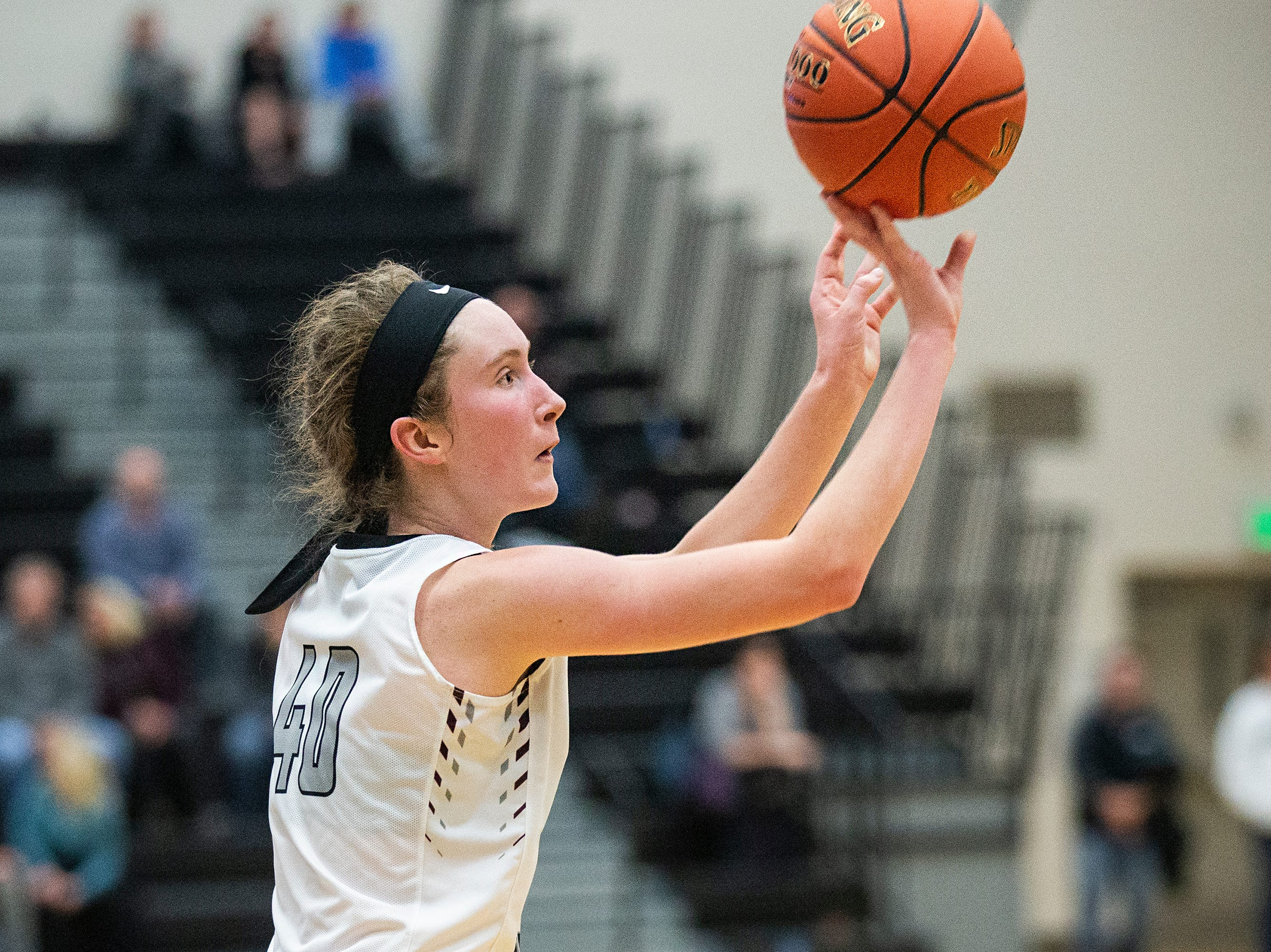 Centennial's Meg Burns shoots the ball during the Southeast Polk vs. Ankeny Centennial girls' basketball game on Tuesday, Nov. 27, 2018, at Ankeny Centennial High School.