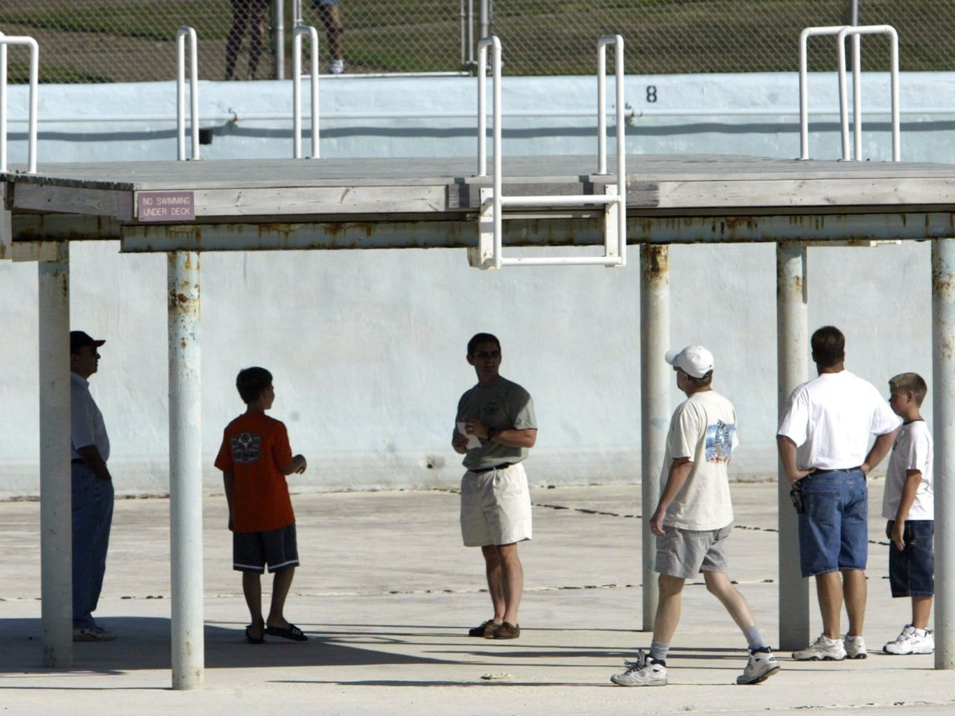 From 2003:  Johnston city leaders and residents interested in renovating the Camp Dodge Pool take a tour of the empty facility. City employees met afterward with National Guard engineers to discuss options on the future of the pool, which never reopened.
