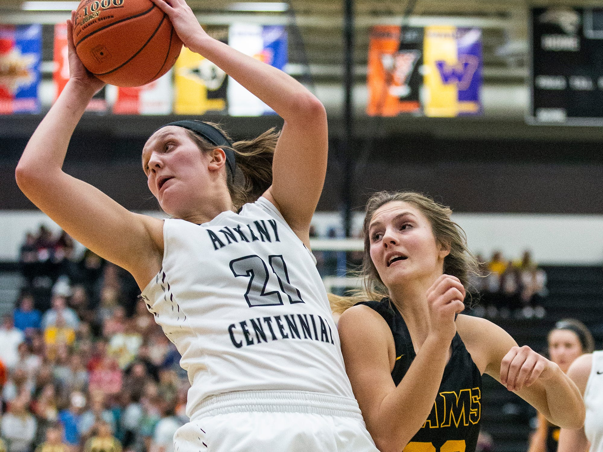 Centennial's Rachel Schon and SEP's Sami Albertson reach for a rebound during the Southeast Polk vs. Ankeny Centennial girls' basketball game on Tuesday, Nov. 27, 2018, at Ankeny Centennial High School.