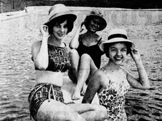 From 1962: Drake University students, from left, Jane Ewing, Lynn Hays and Sue Peterson show off new summer and beach attire for the 1962 swimming season at the Camp Dodge pool.