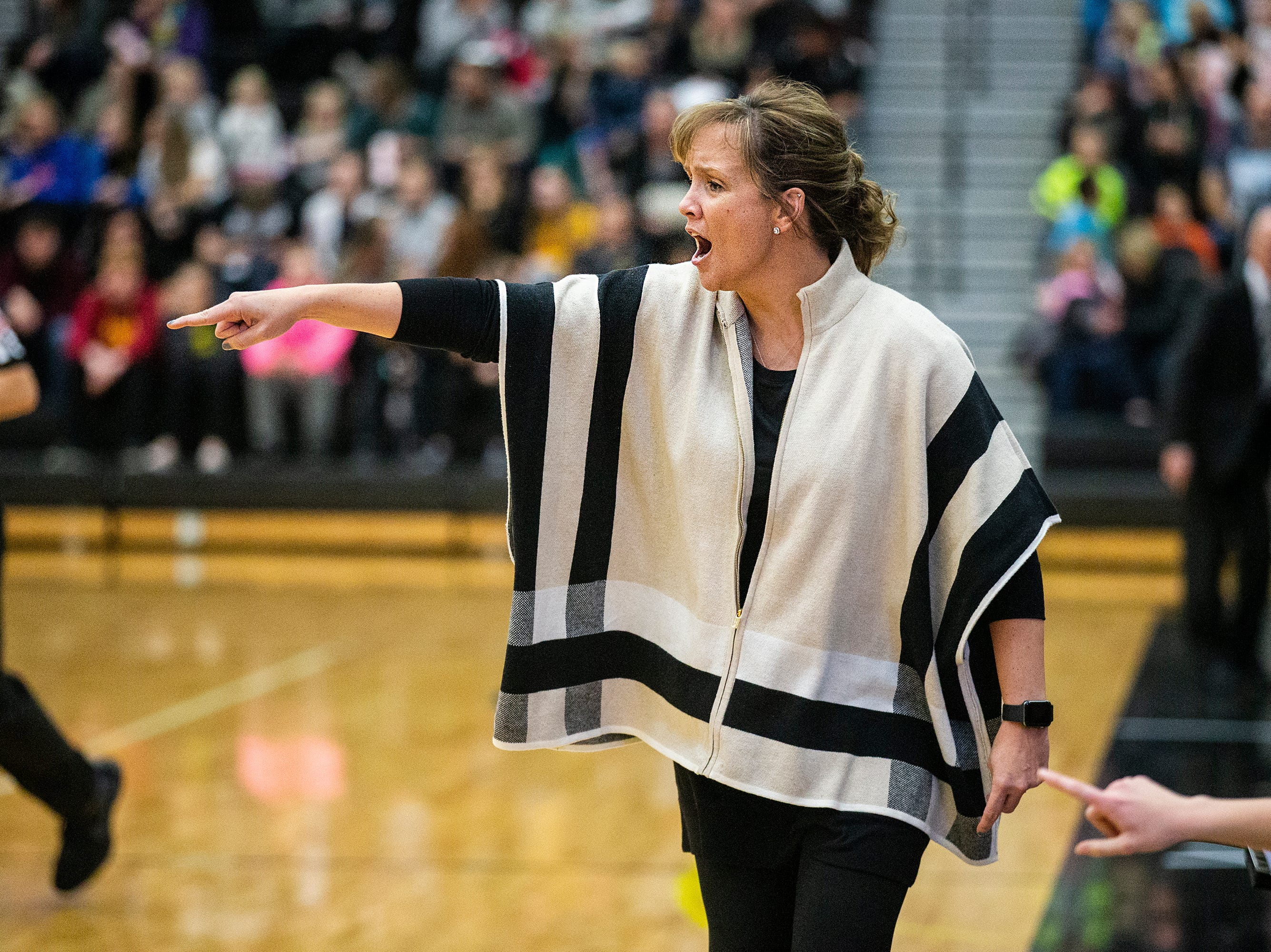 Southeast Polk Coach Tracy Dailey calls out to her team during the Southeast Polk vs. Ankeny Centennial girls' basketball game on Tuesday, Nov. 27, 2018, at Ankeny Centennial High School.
