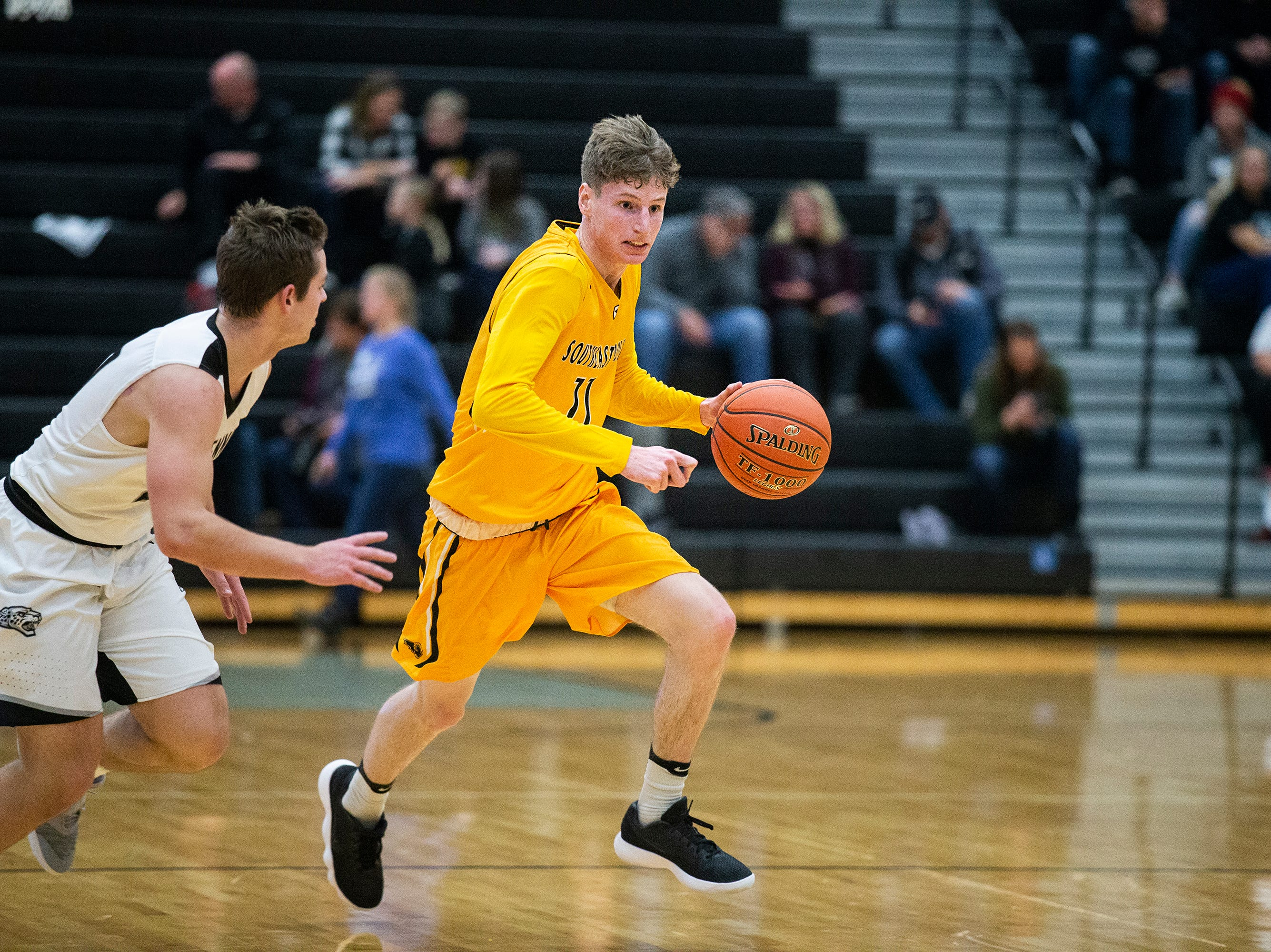 SEP's Sam Glenn brings the ball down the court during the Southeast Polk vs. Ankeny Centennial boy's basketball game on Tuesday, Nov. 27, 2018, at Ankeny Centennial High School.