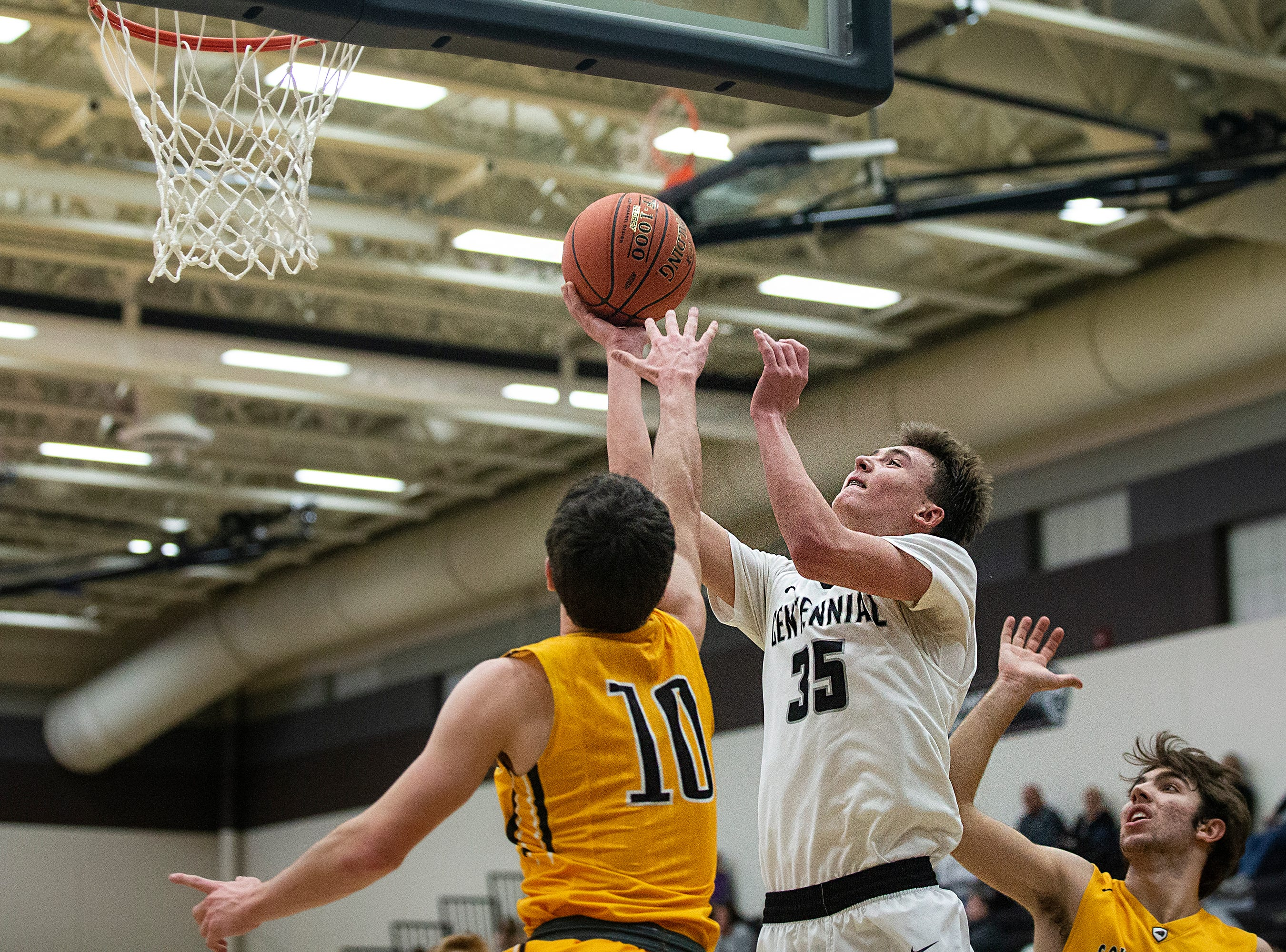 Centennial's Cody McCullough shoots the ball during the Southeast Polk vs. Ankeny Centennial boy's basketball game on Tuesday, Nov. 27, 2018, at Ankeny Centennial High School.