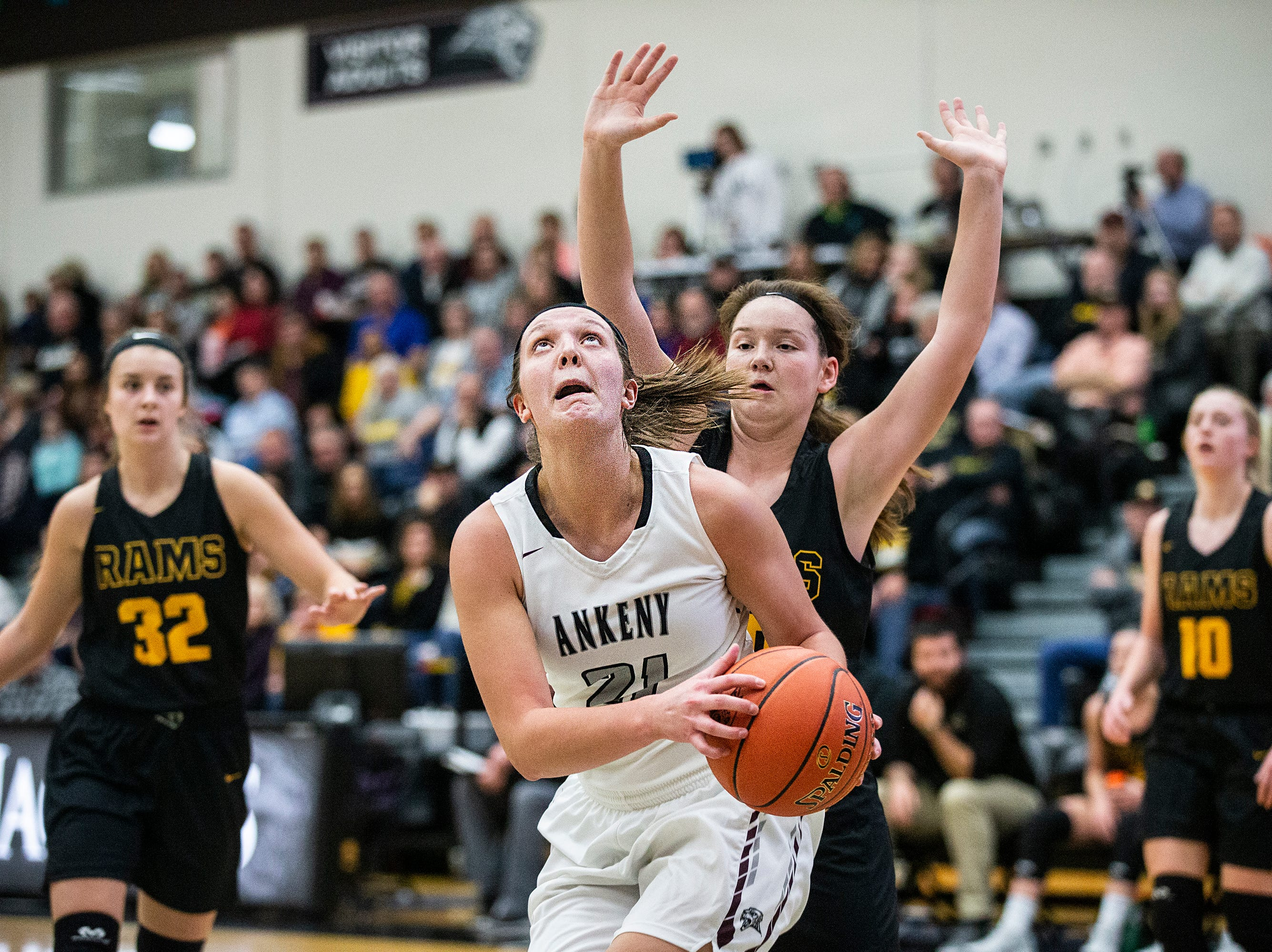 Centennial's Rachel Schon looks to shoot during the Southeast Polk vs. Ankeny Centennial girls' basketball game on Tuesday, Nov. 27, 2018, at Ankeny Centennial High School.