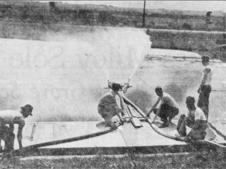 From 1936: Workers spray the first of the 3 million gallons of water that fill the Camp Dodge pool. The filling took 3 days.