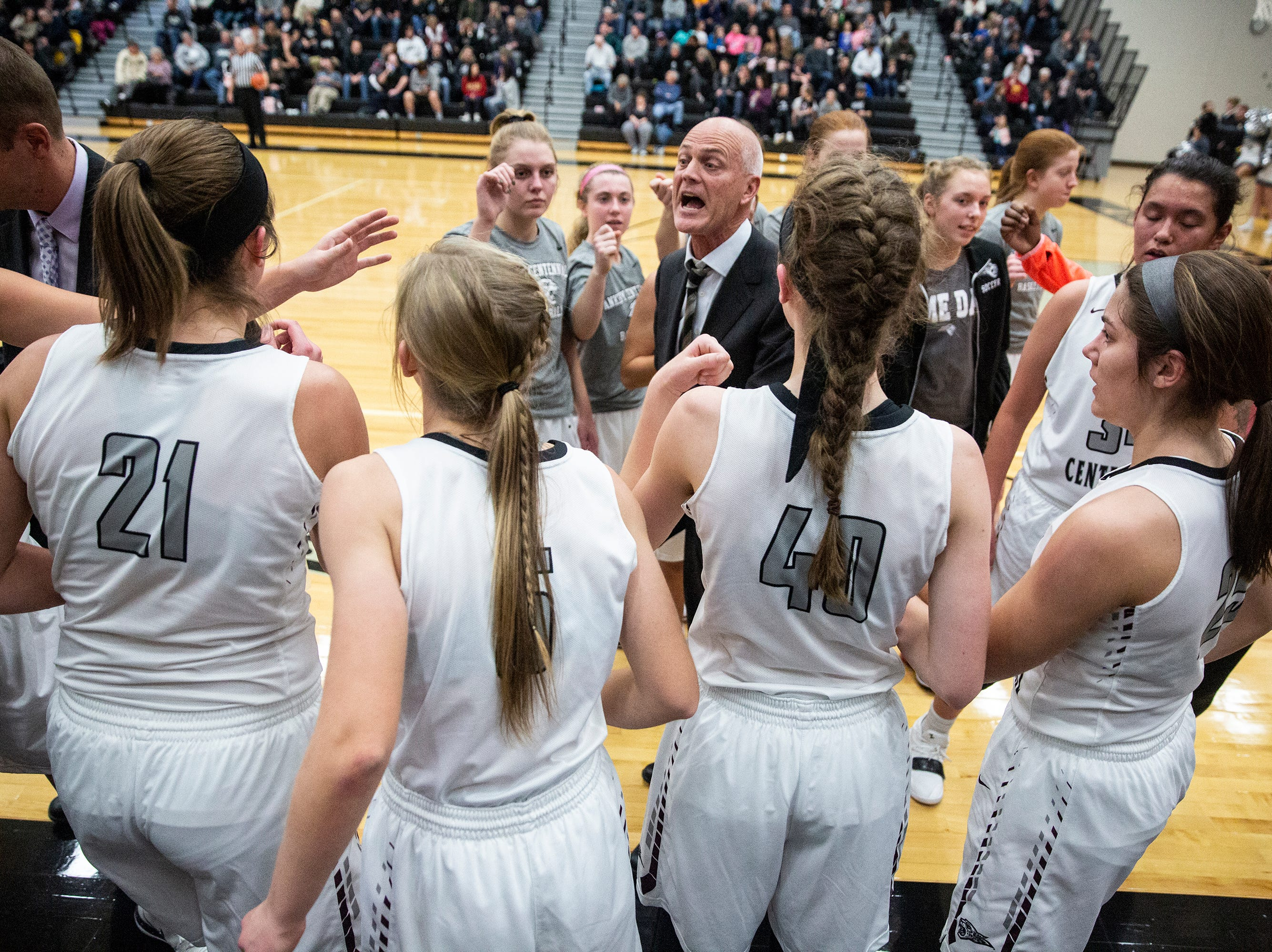 Centennial Coach Scott Dejong talks to his team during a time out during the Southeast Polk vs. Ankeny Centennial girls' basketball game on Tuesday, Nov. 27, 2018, at Ankeny Centennial High School.
