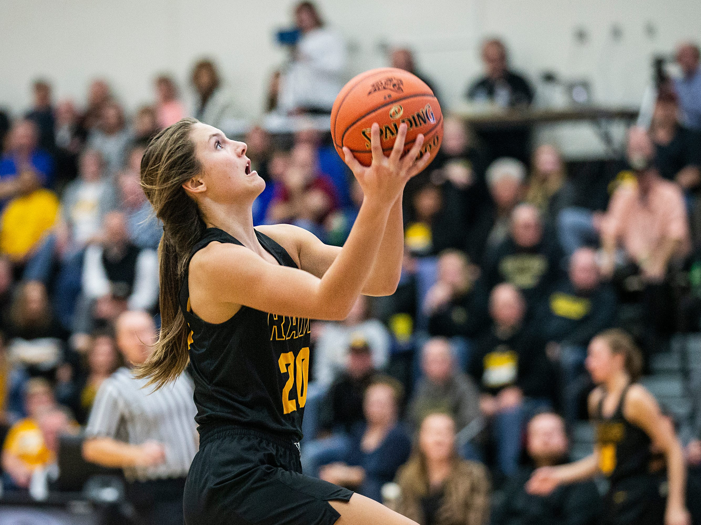 SEP's Sami Albertson drives to the hoop during the Southeast Polk vs. Ankeny Centennial girls' basketball game on Tuesday, Nov. 27, 2018, at Ankeny Centennial High School.