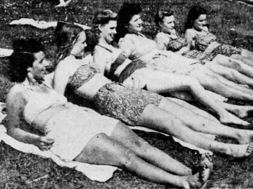 From 1945: Sun bathing was the vogue for these girls between dips in the Camp Dodge pool. Basking on the grass beside the pool are, from left, Gloria Constant, Barbara Unger, Peggy Dougherty, Jennie Henry, Donna Williams and Nancy West, all of Des Moines.