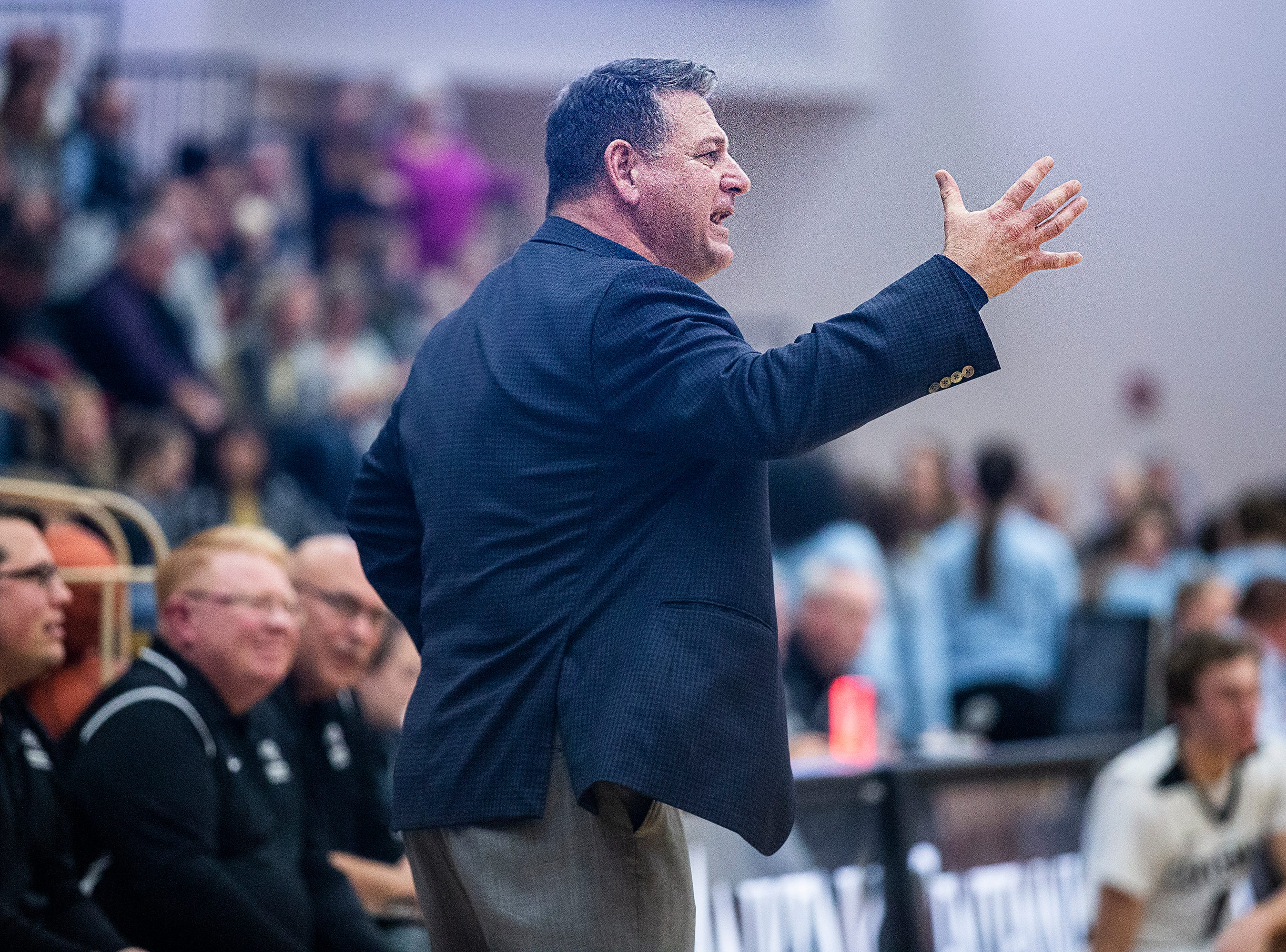 Centennial Coach Bob Fontana calls out to his team during the Southeast Polk vs. Ankeny Centennial boy's basketball game on Tuesday, Nov. 27, 2018, at Ankeny Centennial High School.