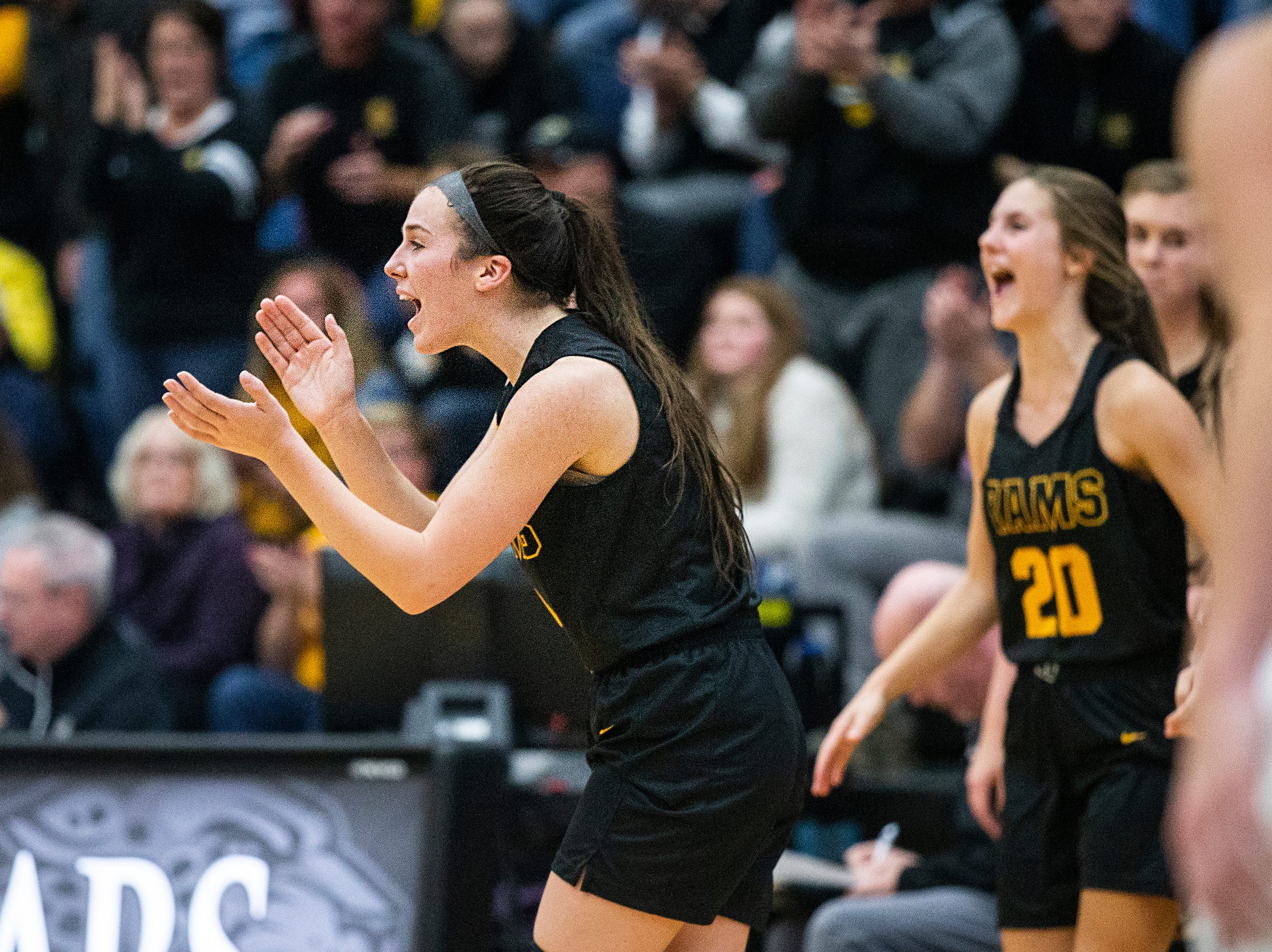 SEP players celebrate after winning the Southeast Polk vs. Ankeny Centennial girls' basketball game on Tuesday, Nov. 27, 2018, at Ankeny Centennial High School.